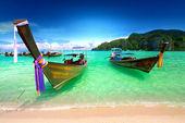 Tropical beach, traditional long tail boats, Andaman Sea, Thailand