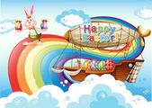 Egy boldog húsvéti sablont, a tojás és a nyuszi közelében a szivárvány