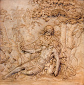 ANTWERP, BELGIUM - SEPTEMBER 5: Marble relief of merciful Samaritan scene in St. Charles Borromeo church on September 5, 2013 in Antwerp, Belgium