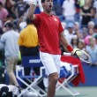 Постер, плакат: Professional tennis player Novak Djokovic celebrating victory after fourth round match at US Open 2013 against Marcel Granollers