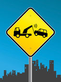 Warning tow away zone sign on urban background