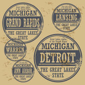 Grunge rubber stamp set with names of Michigan cities vector illustration