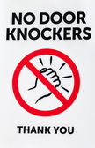 Sign: NO DOOR KNOCKERS THANK YOU