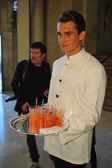 Waiters serve before Ralph Lauren show