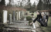 Father and daughter at graveyard