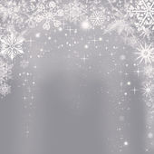 Abstract silver Christmas background with shining snowflakes
