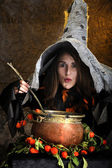 Witch cooking in a copper cauldron