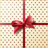 Red ribbon and bow on the gift packaged in a retro style