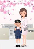 Anya és fia iskolában háttéren cseresznyevirág fák alatt