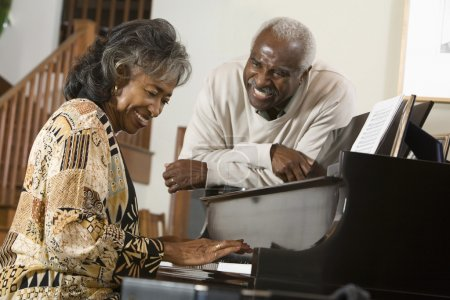 Senior African woman playing piano