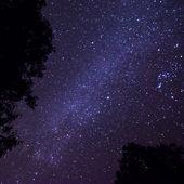 Dark night sky with many stars. Space background