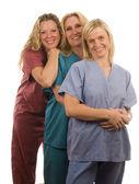 Három ápolók orvosi scrubs ruhák