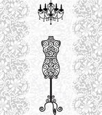 Mannequin and chandelier on lace background