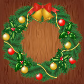 Christmas card with garland on wood background