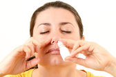 Woman using nasal spray