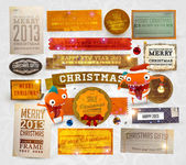 Set of vector Christmas ribbons old dirty paper textures and vintage new year labels Elements for Xmas design: stickers ribbons gifts fur tree branches balls candles and curled papers