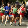 Постер, плакат: Barcelona street crowded of athletes running