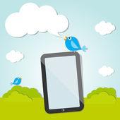 Tweeting blue bird of social nets on the digital tablet