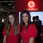 Vodafone hostesses at Smau exhibition in Milan, Italy