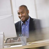 Attractive African American at computer.