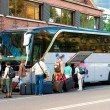 Постер, плакат: Bus for tourists transportation and group of tourists