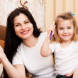 Постер, плакат: Cute little girl with her mother for drawing