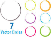 Seven colored vector circles in grunge style
