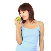 Izolované mladé asijské ženy s zelené jablko