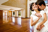 Young happly couple at their new house