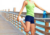 Healthy Young Woman Stretching Her Leg
