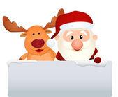 Santa claus s sobů a sněhulák v zimní krajině