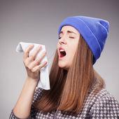 Ona trpí rýma