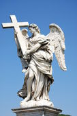 Berninis marble statue of angel with cross from the SantAngelo Bridge in Rome