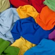 Постер, плакат: Messy colorful clothes background
