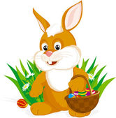 Vector illustration of an Easter Bunny with a basket full of decorated eggs