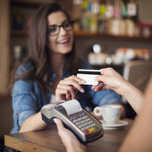 Woman paying  by credit card