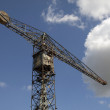 Постер, плакат: Vintage Old crane on a blue sky