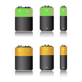 Two battery sets in green and yellow isolated on a white background
