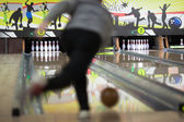 Men bowling out of focus