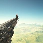 Geschäftsmann, sitzen auf einem Gipfel mit Kaffee