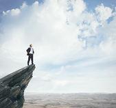 Podnikatel, stojící na vrcholu