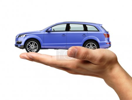 Human hand with a car on the palm.
