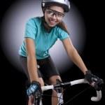 Постер, плакат: Woman over a bike in studio location