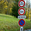 Постер, плакат: Not allowed to go to stop road signs over natural green background road signs on a street road information in nature background photo of many road signs prohibited to go