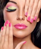 Brunette woman with modern make-up and manicure