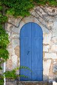 Mediterrenean narrow wooden door