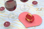 Dárková krabička na pozadí srdce a sklenic vína