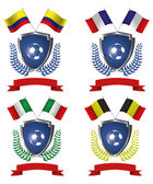 Four shields with ribbons laurel wreaths soccer balls and different flags