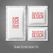 Blank white plastic sachets for coffee sugar salt spices medicine condoms drugs isolated on grey background with place for your design and branding Vector