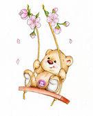 Medvídek houpající se na houpačce